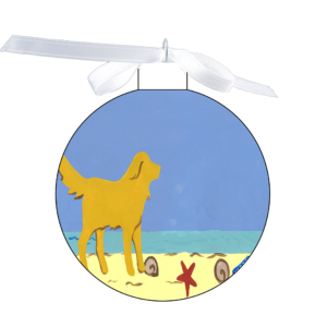 photo of the 80mm Ornament with a yellow dog on the beach