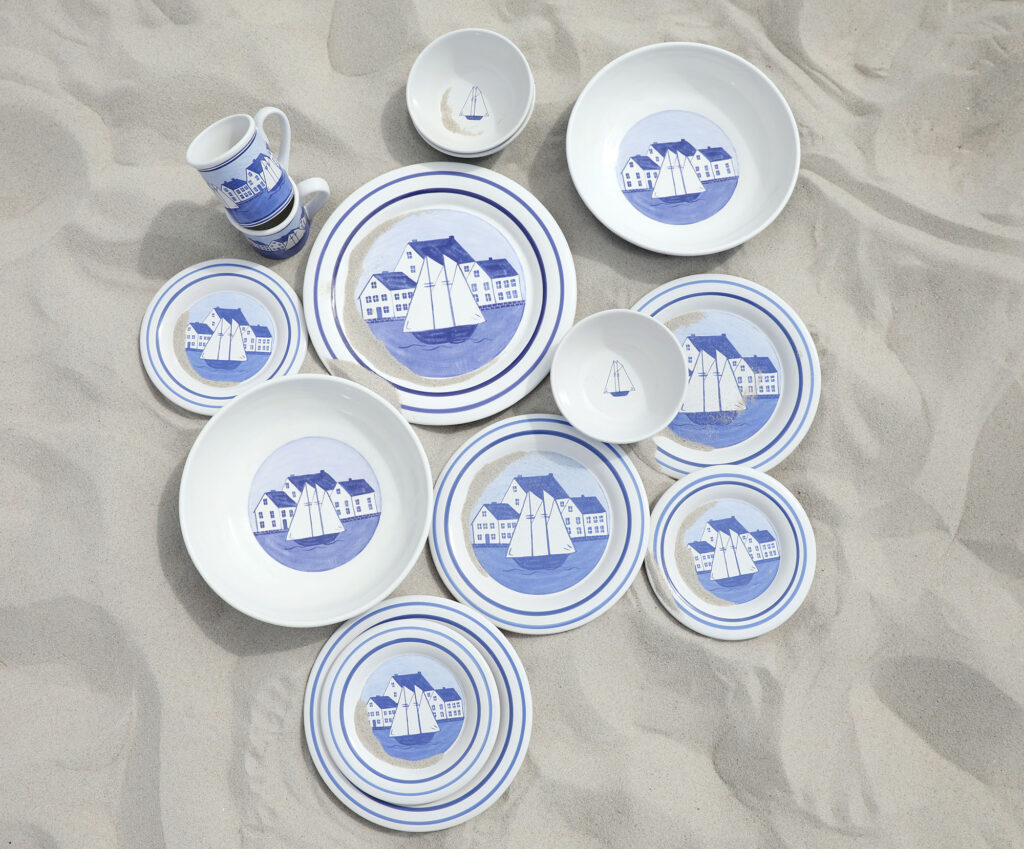 photo of dishes on a sandy beach from the coastal village collection